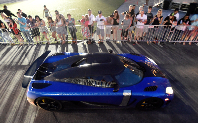 Car number one arrives at the end of the 17th annual Gumball 3000 rally at the MGM Resorts Village on Friday, May 29, 2015. One hundred vehicles participated in a seven-day, transcontinental drivi ...
