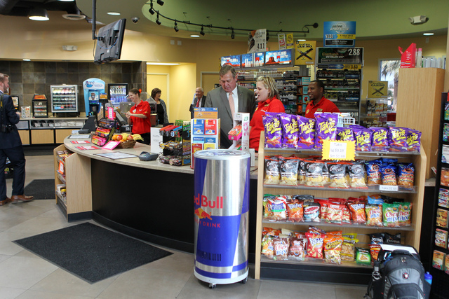 U.S. Rep. Cresent Hardy, R-Nev., center, stands behind the counter at the Green Valley Grocery, 5225 Camino Al Norte, in North Las Vegas with store manager Emily Dages on Wednesday, May 6, 2015. R ...