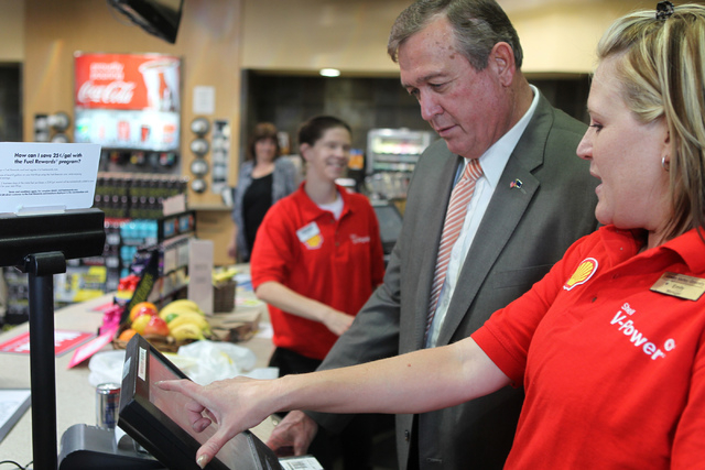 U.S. Rep. Cresent Hardy, R-Nev., left, stands behind the counter at the Green Valley Grocery, 5225 Camino Al Norte, in North Las Vegas with store manager Emily Dages on Wednesday, May 6, 2015. Rep ...