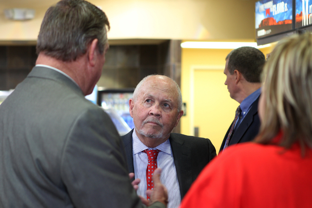 Richard Crawford, center, president of Green Valley Grocery stores, listens to U.S. Rep. Cresent Hardy, R-Nev., during a visit to Green Valley Grocery, 5225 Camino Al Norte, in North Las Vegas Wed ...
