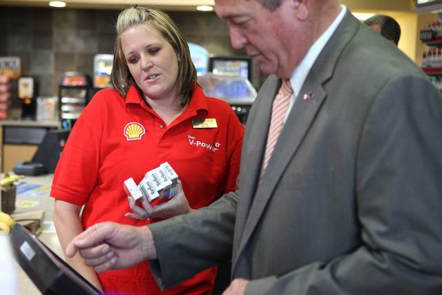 U.S. Rep. Cresent Hardy, R-Nev., right, rings up a customer at the Green Valley Grocery, 5225 Camino Al Norte, in North Las Vegas with store manager Emily Dages on Wednesday, May 6, 2015. Rep. Har ...