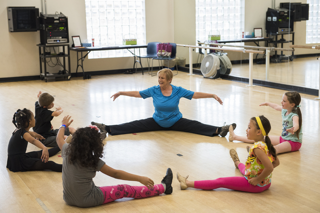 Dance instructor Lori Day, center, teaches her students, clockwise from right, Alaina Michaelson, 8, Abby Watanabe, 7, Elan Turner, 7, Imani Reed, 7, and Garrett Rehfeld, 10, how to properly stret ...