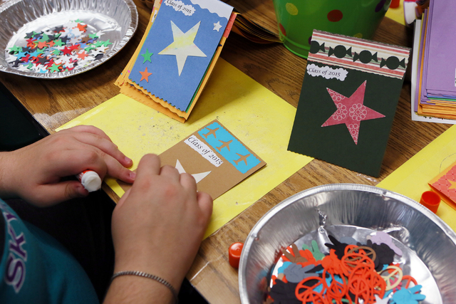 Peyton Petrillo works on a greeting card in Lisa Cipriano's special education class at Silverado High School Wednesday, May 13, 2015, in Henderson. All proceeds from the cards, which are sold at s ...