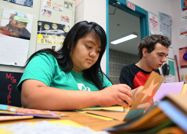 Kealani Buenaventura, left, and Haydn Ream (cq) make greeting cards in Lisa Cipriano's special education class at Silverado High School Wednesday, May 13, 2015, in Henderson. All proceeds from the ...
