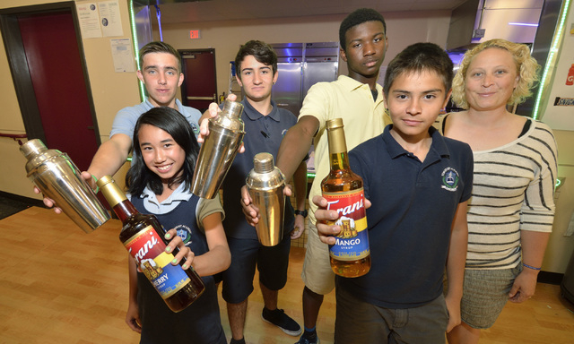 The team behind Under the Shark Juices is shown at the Somerset Academy of Las Vegas at 50 N. Stephanie St. in Henderson on May 5, 2015. Team members are, from left, Claire Pormento, finance lead, ...