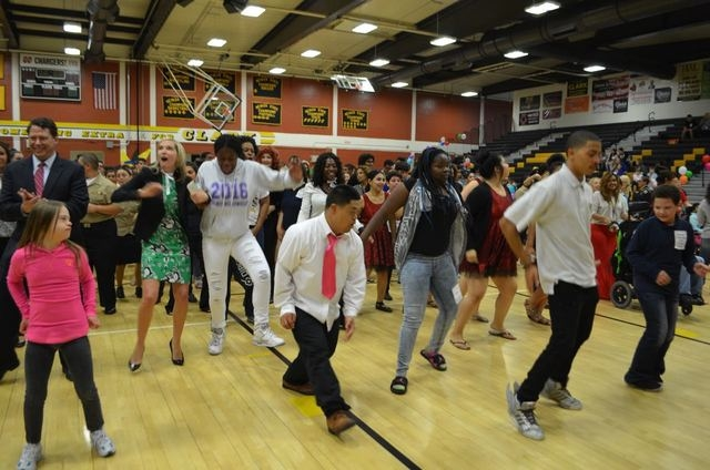 A crowd that includes Clark County School District Superintendent Pat Skorkowsky, left, and Clark High School principal Jillyn Pendleton dances May 5 at Clark High School. (Ginger Meurer/Special t ...