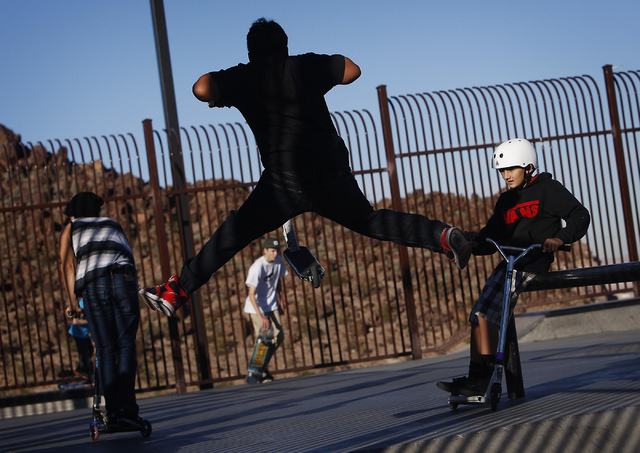 Jayden Bojko, right, watches fellow scooter rider Davon Hood pull off a trick while hanging out at the Hidden Falls Park skateboard facility in Henderson on Jan. 2, 2014. (Jason Bean/Las Vegas Rev ...