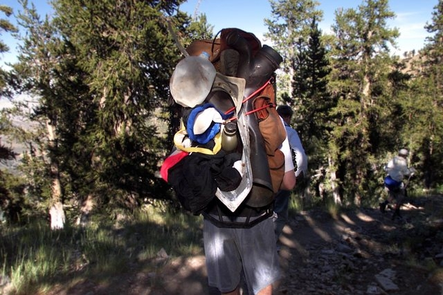 Eric Christiansen starts down the switchbacks on Mount Charleston's South Loop Trail, on Aug. 4, 2001, packing down pieces of the exhaust manifold of the Air Force C-54 transport plane that crashe ...