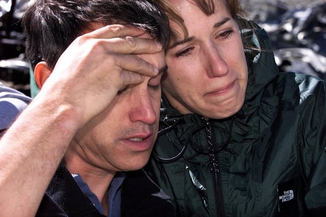 Steve Peterso, left, and Brenda Cummings cling to each other during a memorial service on Aug. 4, 2001, held at the site of the 1955 Air Force C-54 transport plane crash near Mt. Charleston peak t ...