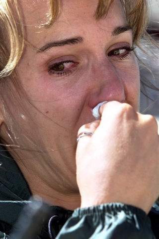 Brenda Cummings cries during a memorial service on Aug. 4, 2001, held at the site of the 1955 Air Force C-54 transport plane crash near Mount Charleston peak that killed her grandfather, Richard J ...