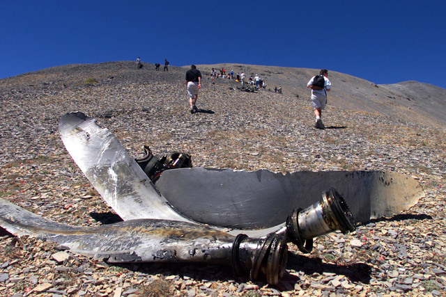 The propeller of an Air Force C-54 transport plane lies near the trail as hikers make their way up to the site near the Mount Charleston summit on Aug. 4, 2001, where the plane crashed in 1955, ki ...