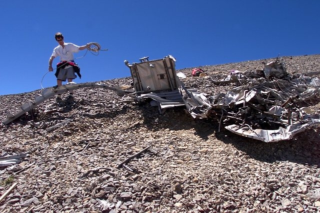 Eric Christiansen works amid the debris of the Air Force C-54 transport plane on Aug. 4, 2001, that crashed near the Mount Charleston summit in 1955. This during the Silent Heroes of the Cold War  ...