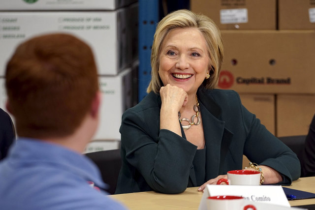 Presidential candidate and former Secretary of State Hillary Clinton listens to small-business owners as she campaigns for the 2016 Democratic presidential nomination at Capital City Fruit in Norf ...