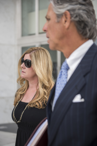 Defendant Lisa Kim, left, who is being sentenced in the HOA fraud scheme is seen with her attorney Charles Kelly outside the Lloyd George Federal Courthouse in Las Vegas on Wednesday, May 20, 2015 ...