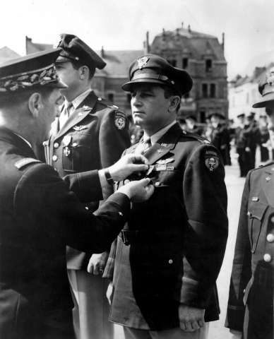 A French officer pins the Croix de Guerre [Cross of War] on U.S. Army Air Corps Lt. Col. Howard Cannon, during an award ceremony, sometime after VE Day [Victory Europe] in 1945. Cannon, who served ...