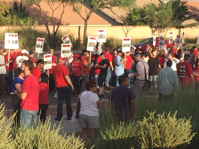 Members of Culinary Workers Union Local 226 gather on Thursday, Oct. 9, 2014 near Palo Verde High School on Pavilion Center Drive in Las Vegas, Nev., for a march and rally against Station Casinos. ...