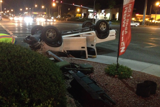 A Toyota pickup sits on its top after a two-car accident at the intersection of Fort Apache Road and Flamingo Road on Monday, May 11, 2015. (Greg Haas/Las Vegas Review-Journal)