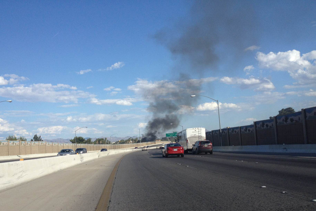 Smoke can be seen rising in the sky on US-95 south near the Charleston exit. (Kristen DeSilva/Las Vegas Review-Journal)