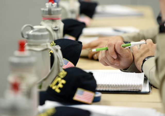 A recruit sits ready to take notes during a Las Vegas Metropolitan Police Department Recruits Academy diversity and cultural awareness training class at Metro Training Center Tuesday, May 12, 2015 ...