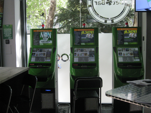 Sports wagering terminals inside the Bet Bar wagering parlor in Madrid await customers on April 20, 2015. The legal gambling facility is located across from Estadio Santiago Bernab鵬 home of ...
