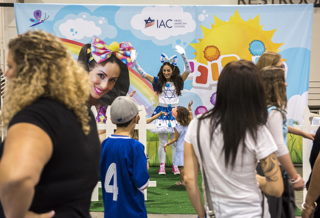 Entertainer Ponponim dances with children during Israel Fest inside the Venetian hotel-casino in Las Vegas on Sunday, May 10, 2015. (Martin S. Fuentes/Las Vegas Review-Journal)