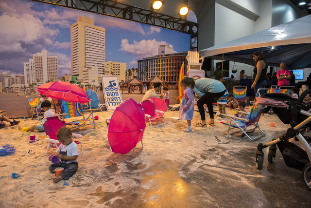 Patrons enjoy a replica of a Tel Aviv Beach during Israel Fest inside the Venetian hotel-casino in Las Vegas on Sunday, May 10, 2015. (Martin S. Fuentes/Las Vegas Review-Journal)