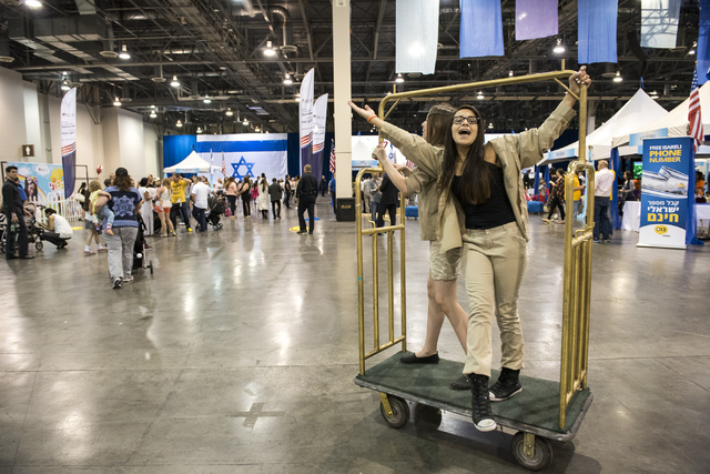 Isreali Scouts from right, Hailey Nemeth, 12, and Lia Jenseh, 12, sing and celebrates Israel Fest inside the Venetian hotel-casino in Las Vegas on Sunday, May 10, 2015. (Martin S. Fuentes/Las Vega ...