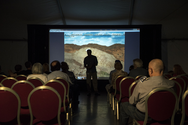 Patrons prepare to watch a short documentary film on the Western Wall during Israel Fest inside the Venetian hotel-casino in Las Vegas on Sunday, May 10, 2015. (Martin S. Fuentes/Las Vegas Review- ...