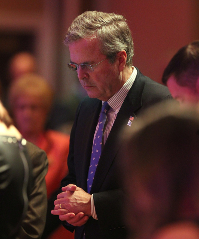 Former Florida Gov. Jeb Bush bows his head in prayer during a Clark County Republican Party dinner Wednesday, May 13, 2015, at the Orleans. (Sam Morris/Las Vegas Review-Journal) Follow Sam Morris  ...