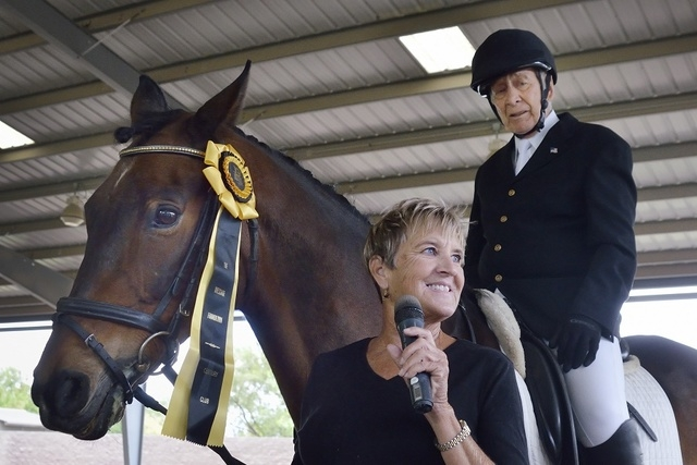 Ann King, center, is shown with Thann Hanchett, 79, right, and King's 21-year-old horse Magellan after the horse and rider completed a Century Ride at the Cooper Ranch at 6860 Rome Blvd. in Las Ve ...