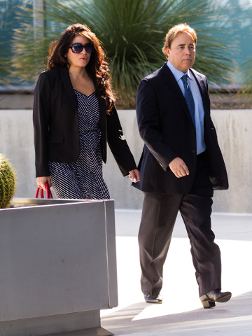 Urologist Michael Kaplan walks with his wife toward the Lloyd George U.S. Courthouse on Tuesday morning, May 5, 2015. Kaplan is slated to appear for sentencing over his conviction for reusing equi ...