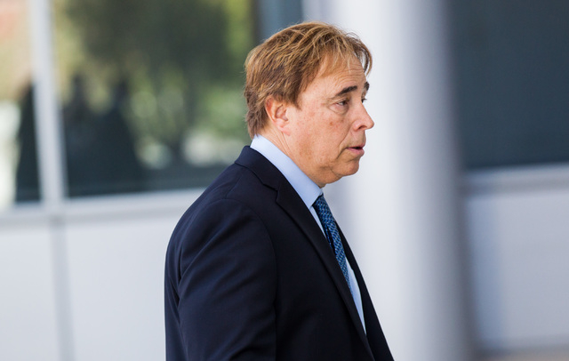 Urologist Michael Kaplan walks toward the Lloyd George U.S. Courthouse on Tuesday morning, May 5, 2015. Kaplan is slated to appear for sentencing over his conviction for reusing equipment meant fo ...