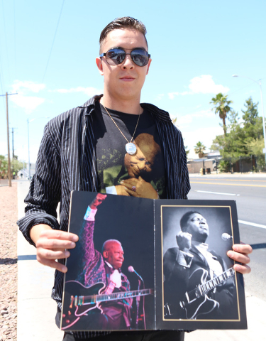 Roger Lewis of Squamish, British Columbia, holding the 2011 B.B. King's tour program, stands outside Palm Mortuary Downtown on 1325 N. Main St., where King's memorial service was held on Saturday, ...