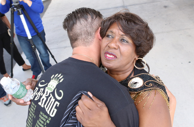 B.B. King's daughter Shirley King, right, hugs Roger Lewis of Squamish, British Columbia, outside Palm Mortuary Downtown, 1325 N. Main St., where B.B. King's memorial service was held on Saturday, ...