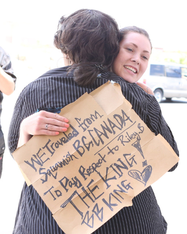 B.B. King's daughter Shirley King, left, hugs Alaina Eaton of Squamish, British Columbia, outside Palm Mortuary Downtown, 1325 N. Main St., where B.B. King's memorial service was held on Saturday, ...