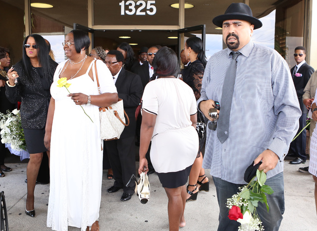 B.B. King's daughter Patty King, second left, and blues-rock guitarist Wayne Baker Brooks, right, leave Palm Mortuary Downtown after attending B.B. King's memorial service on Saturday, May 23, 201 ...