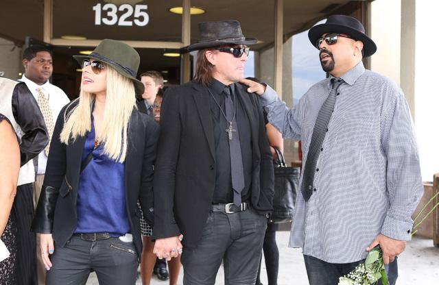 Singer/songwriter Orianthi Panagaris, left, her boyfriend, guitarist Richie Sambora, and blues-rock guitarist Wayne Baker Brooks leave Palm Mortuary Downtown after attending B.B. King's memorial s ...