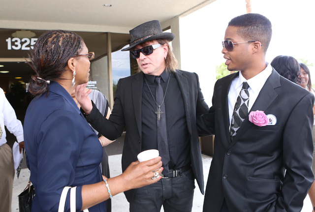 B.B. King's daughter Rita Washington, her son Gallegher, right, and guitarist Richie Sambora leave Palm Mortuary Downtown after attending B.B. King's memorial service on Saturday, May 23, 2015. (B ...