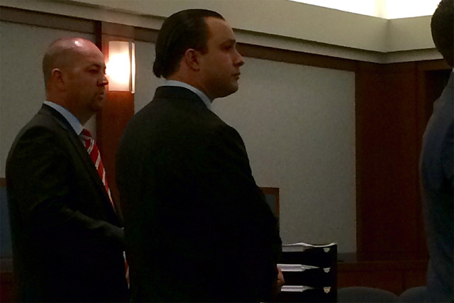 Former Metro detective Michael Kitchen, right, standing next to his attorney Roy Nelson, agrees to plead guilty Tuesday May 5, 2015 in connection with an alleged attack on a prostitute. (David Fer ...