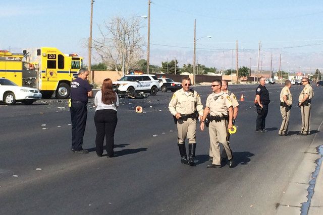 Las Vegas police investigate a fatal accident where a motorcyclist died and a child was critically injured in the 4600 block of East Lake Mead on Thursday, May 7, 2015. (Bizuayehu Tesfaye/Las Vega ...