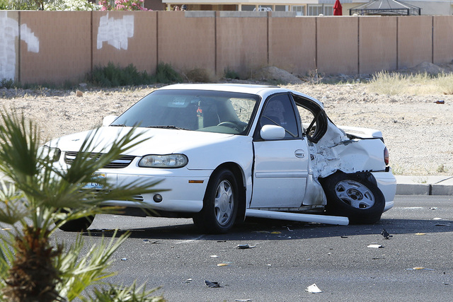 The car involved in a crash with motorcyclist sits near the crash site where a motorcyclist died and a child is seriously injured, Thursday, May 7, 2015, at 4650 Lake Mead Blvd. (Bizuayehu Tesfaye ...