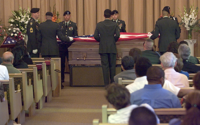 U.S. Army Honor Guard soldiers fold the American flag above the casket of Staff Sgt. Emmanuel Laderas Legaspi during funeral services at Palm Mortuaries on South Jones Boulevard, Thursday, May 18, ...