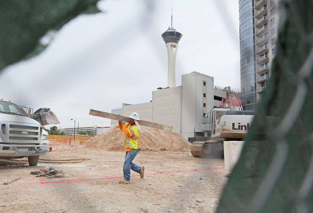 Construction is shown through a fence at the site of Lucky Dragon hotel-casino Friday, May 22, 2015, in Las Vegas. (Ronda Churchill/Las Vegas Review-Journal)