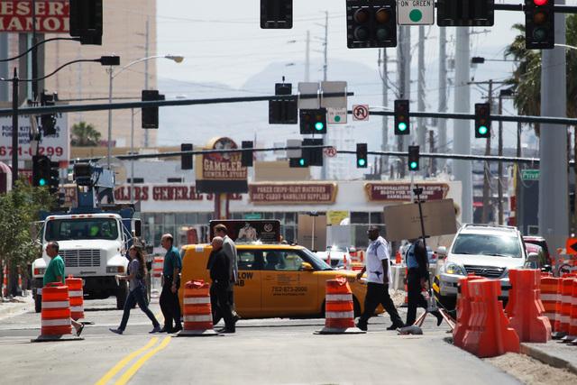 Pedestrians cross Main Street amidst construction in downtown Las Vegas Tuesday, May `19, 2015. (Sam Morris/Las Vegas Review-Journal) Follow Sam Morris on Twitter @sammorrisRJ