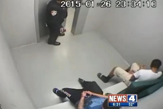 The video, dated January 26, 2015, shows two teens sitting in a holding area at the Alton Police Department. (Screengrab, KMOV)