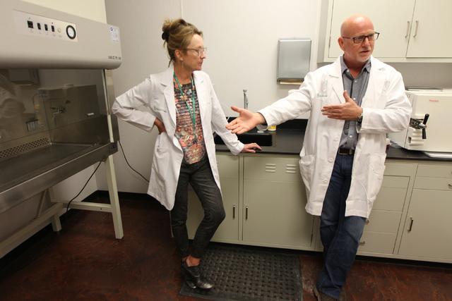 DigiPath Labs employees Dr. Cindy Orser, left, chief science officer, with CEO Todd Denkin, are interviewed during a tour of the DigiPath Labs facility in Las Vegas Wednesday, April 15, 2015. Digi ...