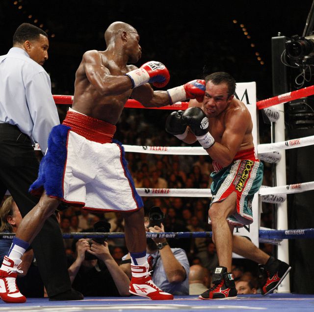 Floyd Mayweather hits Juan Manuel Marquez in the 6th round during their fight at the MGM Grand in Las Vegas Saturday, Sept. 19, 2009. (John Locher/Las Vegas Review-Journal)