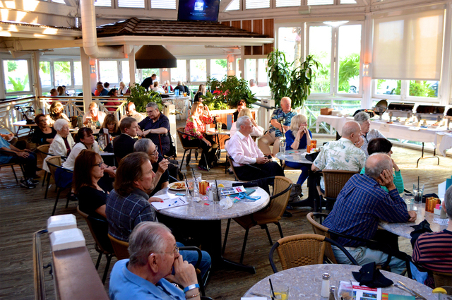 Attendees listen during the Friends of Parkinson's Meet and Greet April 24, 2015, at Bahama Breeze restaurant. Attendees met the Board of Advisors, community supporters and Parkinson's disease car ...