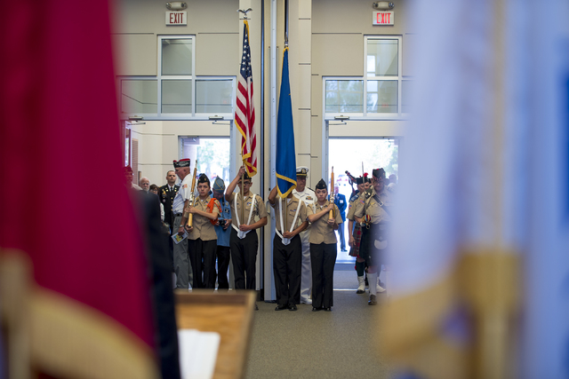 The Colors are presented by the Chaparral High School NJROTC Honor Guard during the Memorial Day celebration at the Southern Nevada Veterans Memorial Cemetery in Boulder City, Nev. on Monday, May  ...