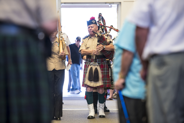A piper leads the way during the Memorial Day celebration at the Southern Nevada Veterans Memorial Cemetery in Boulder City, Nev. on Monday, May 25, 2015. (Joshua Dahl/Las Vegas Review-Journal)